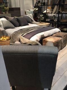 Love the mix of materials and colors! Cozy bedding mix.