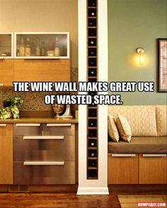 Wine Wall- great idea for storage! Oh he'll yea. Might need one in every corner of kitchen. Hmmmm