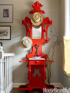 Lacquered red, a Victorian hat rack becomes even more sculptural.