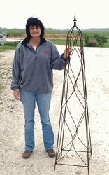 $129.95 Biggest Metal Square Finial Flower Topiary Metal Topiaries & Obelisks Strong and tall topiary for your garden vines. Measures 68 tall by 16 wide. When