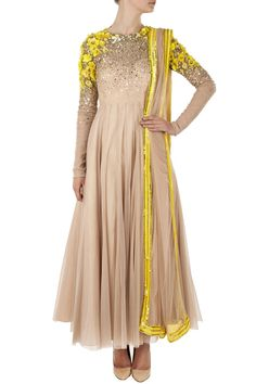 nude net overlay anarkali with yellow sequin beaded flowers and dabka work around shoulders and scattered sequin on bodice.