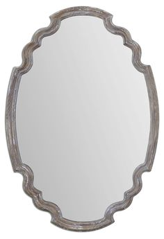 With an ornate shape and an aged wood finish accented with a gray wash, this mirror is a beautiful blend of rustic and classic.