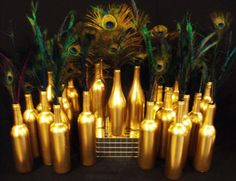 We could also use the feathers in the gold spray painted wine bottles. DS