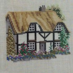 Completed Cross Stitch Herefordshire Cottage England on Linen Custom Framed