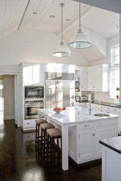 All white kitchen; like the cabinets in island + bar stools