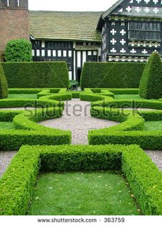 stock photo : An English knot garden with a half timbered manor house in the background Garden Hedges, Topiary Garden, Garden Steps, Topiaries, Indoor Garden, Landscape Design, Garden Design, Contemporary Landscape, Landscape Architecture