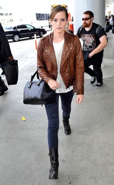 Emma Watson from Celeb Airport Style The British actress arrives for a departing flight out of LAX sporting a brown leather jacket, textured white blouse, jeans and leather boots.