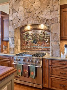 Designer Heather Guss incorporated wood trim and decorative stone accents to give this transitional kitchen area country appeal.