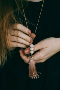 The Classic Tassel Necklace by FashionAble features a mixture of white bone beads + a colored tassel for a necklace that will go with any outfit! Handmade in Nashville, TN with ethically sourced materials.