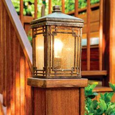 Cap posts with carriage lights to provide both an attractive accent and welcome nighttime illumination. Here, wiring runs from the house, under the deck, and up the hollow posts. | Photo: Mark Lohman