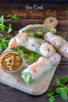 Lower Carb Shrimp Spring Rolls Shrimp spring rolls on a cutting board, with mint sprigs and peanut dipping sauce with title banner Shrimp Spring Rolls, Fresh Spring Rolls, Chicken Spring Rolls, Fresh Rolls, Shrimp Rolls, Rice Paper Spring Rolls, Recipe For Spring Rolls, Shrimp Salad Rolls Recipe, Snacks