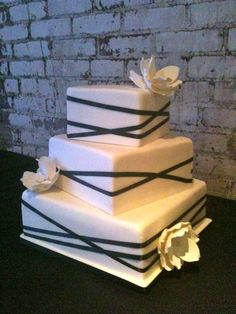 square wedding cakes Love the offset squares with the ribbon, different flowers and more color. But great basic concept for a modern wedding Square Wedding Cakes, Square Cakes, Cool Wedding Cakes, Wedding Cake Designs, Cheap Wedding Flowers, Wedding Cakes With Flowers, Trendy Wedding, Our Wedding, Wedding Ideas