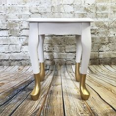 Adding a little touch of glamour to a previously very ordinary nest of tables. Using Dulux emulsion as a base & Rustoleum metallic spray for the foxy gold feet.