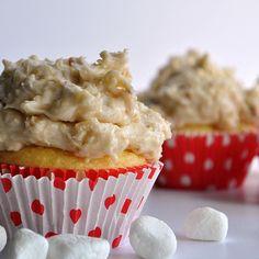 Caramel buttercream frosting mixed with Samoa Rice Krispie treats on top of a moist vanilla cupcake.