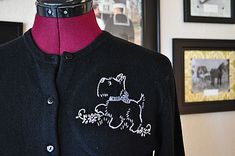 How to add pizzazz to an old sweater with an embroidery embellishment. Tutorial includes doggy pattern, plus links to several other free images.