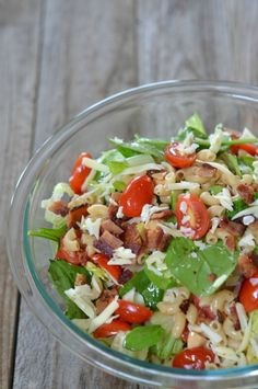 Whole wheat pasta, romaine and spinach, crispy bacon, cherry tomatoes, swiss cheese, almonds and a garlic-y lemon vinaigrette is a take on one of my favorite childhood salads: Salad de Maison.