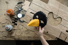 DIY Scary Bird Mask Materials: Glue gun (or regular glue)Scissors or exacto knifeString, twine or elasticFelt (in the colours of your choice)Cardboard (a Greenhouse Delivers box works well, hint hint, nudge nudge)Spray paint (or regular paint)Steps:Cut a piece of cardboard into the mask shape of your choice.Hold the mask-shaped cardboard up to your face to determine where to cut holes for eyes (provided you want to be able to see through the mask). You may want to ask a friend to help you…