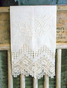 guest towels with exquisite monograms and the most gorgeous lace -- so pretty!