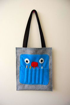 Crayon Monster art tote tutorial by Hideous Dreadful Stinky. The crayon/pencil storage doubles as teeth, very cute.