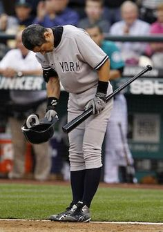 Ichiro Suzuki received a standing ovation from Mariners fans in his first at-bat as a New York Yankee and responded with a bow -- and a single.