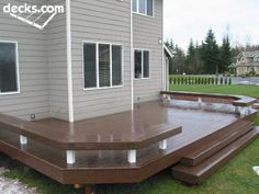 With extra wide deck steps and built in benches instead of rails, this low elevation deck provides an attractive and functional way to transition to the backyard.