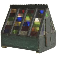 Folk Art Colored Glass Greenhouse, England, Late 19th Century  England  Late 19th Century  Miniature Folk Art Greenhouse with Colored Glass Tile Roof and Doors at Opposite Ends.