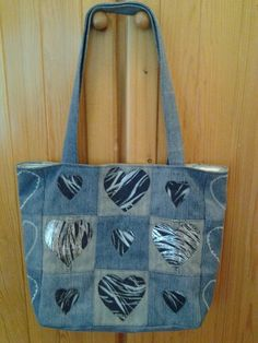 Recycle denim bag with applique, embroidery and drop-in lining.