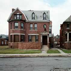 this house looks like its in pretty good shape.  Love the street name above the door