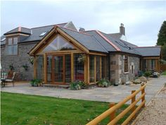 sunrooms build on houses | Exterior of a timber-frame home in Scotland created by Lawrie Orr