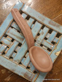 Spoon a Day Challenge, Make 365 Clay Spoons in 2015: Day 69. I am experimenting with a narrow handle. I am concerned that it will be too fragile to hold up to much use. I will test it out. I love the sleek lines it has! I again used the darker clay that look...