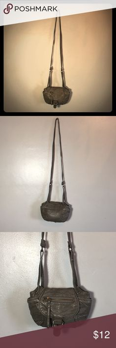 "American Eagle Gray Crossbody Purse American Eagle Crossbody Purse Faux Leather Cute Small Purse with room for cell phone and slots for credit cards inside Measures 6.5"" H x 9"" W Adjustable strap is 48"" long fully extended Gently Used American Eagle Outfitters Bags Crossbody Bags"
