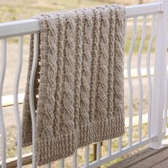 CROCHET: Wrap up in this luxuriously thick and cozy decorative throw. This beautiful cabled throw is crocheted - download the pattern from LoveKnitting!
