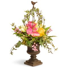 This topiary is a colorful decoration for display in doorways, hallways, porches and patios. Featured are pink and yellow flower blooms and berry clusters seated in a cushion of leafy green stems, all flowing from a decorative urn base. Rising over the flowers is a plant stem crown topped with a bird finial. For use in indoor or covered outdoor locations.