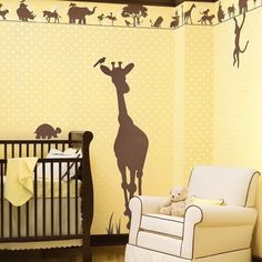 yellow jungle themed nursery with giant giraffe on the wall