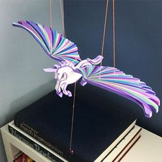 Unicorn mobiles fly well in the kid's playroom or reading corner. #unicorns #kidsroom #playroom #pegasus #alicorn #purple #girlsroom #shopwithapurpose #shoppingonline #handmade #fairtrade @tuliasartisangallery