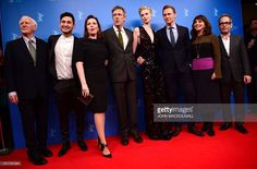British writer John Le Carre, actor Amir El-Masry, actress Olivia Colman, British actor Hugh Laurie, French actress Elizabeth Debicki and British actor Tom Hiddleston, Danish director Susanne Bier, actor Tom Hollender pose for photographers as they arrive for a sreeening of Berlinale Special Series ' The Night Manager ' by Danish Susanne Bier and British David Farr screended during the 66th Berlinale Film Festival in Berlin on February 18, 2016. / AFP / John MACDOUGALL