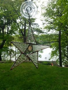 Stained glass star using left over pieces of glass with a small fused glass drop in the center.   5/25/15