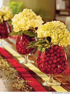 Winter wedding centerpiece idea on a budget | Cranberries, hydrangea and evergreen leaves in a brandy snifter. Source: Southern Living via Kiss Wedding #diy #centerpiece #winterwedding