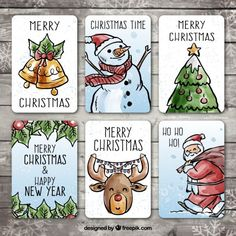 Pack of hand-drawn christmas cards with watercolor effect Free Vector