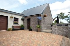 River Stone paving in Slaney (with Slate Setts, Lanyon brick walling in Basalt)