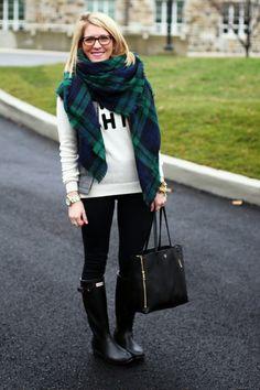 Hunter boots, leggings, graphic sweatshirt, plaid blanket scarf.