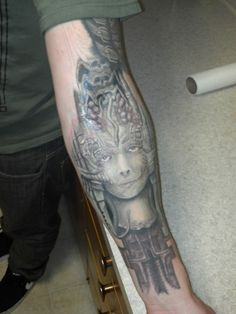 This is a part of my H.R Giger sleeve. I have always loved his work. This is a color piece whice is very unlike his work generally is. Work by scott falbo