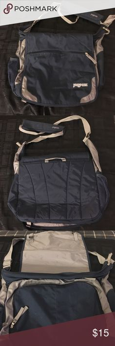 Jansport Messenger Bag Jansport Messenger Bag- excellent used condition!  Measures about 19'' across & 12'' high.  See pictures- lots of zippered pockets.  Strap is adjustable.  Great personal carry-on or travel bag.  Jansport bags are high-quality with lifetime guarantees. Navy blue. Jansport Bags Travel Bags