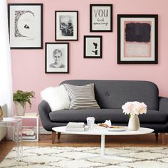 Black and white prints, Rothko print, gray couch and striped pillow.
