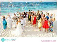 Colourful confetti flower toss on the beach for a destination wedding in The Caribbean. Brilliant Studios, Turks and Caicos