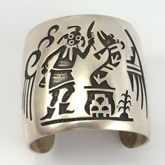 """Vintage Sterling Silver Cuff Bracelet with an Intricate Hopi Overlay Design of Rain Clouds, a Mudhead, and a Water Serpent. 2.25"""" Cuff Width 5.125"""" Inside Measurement, plus 1.25"""" opening 6.375"""" Total"""
