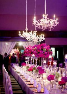 Combining bold colors in your lighting and flowers makes for a dramatic yet gorgeous wedding reception! #pinkweddings