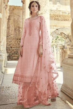 Let the next ethnic occasion see you flaunt a mesmerisingly vibrant avatar wearing this salmon pink georgette sharara suit which will be scene-stealing ethnic wear to shine in the spotlight. This u neck and full sleeve garment decorated using dori work. Available with net sharara pant in salmon pink color with salmon pink net dupatta. Sharara pant has dori work. #shararasuits #malaysia #Indianwear #weddingwear #andaazfashion Elegant Dresses, Pretty Dresses, Beautiful Dresses, Pakistani Outfits, Indian Outfits, Designer Wear, Designer Dresses, Sharara Suit, Salwar Kameez
