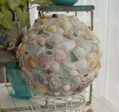 A bowling ball... seashells and sea glass, with a sprinkling of sand