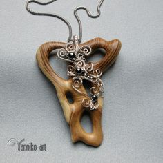 OOAK wire wrapped, hand carved wooden pendant.